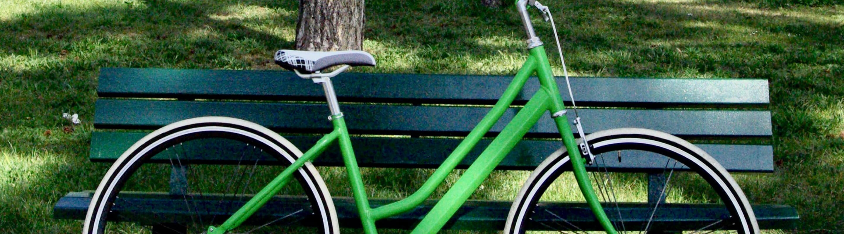 Bike leaning up against park bench